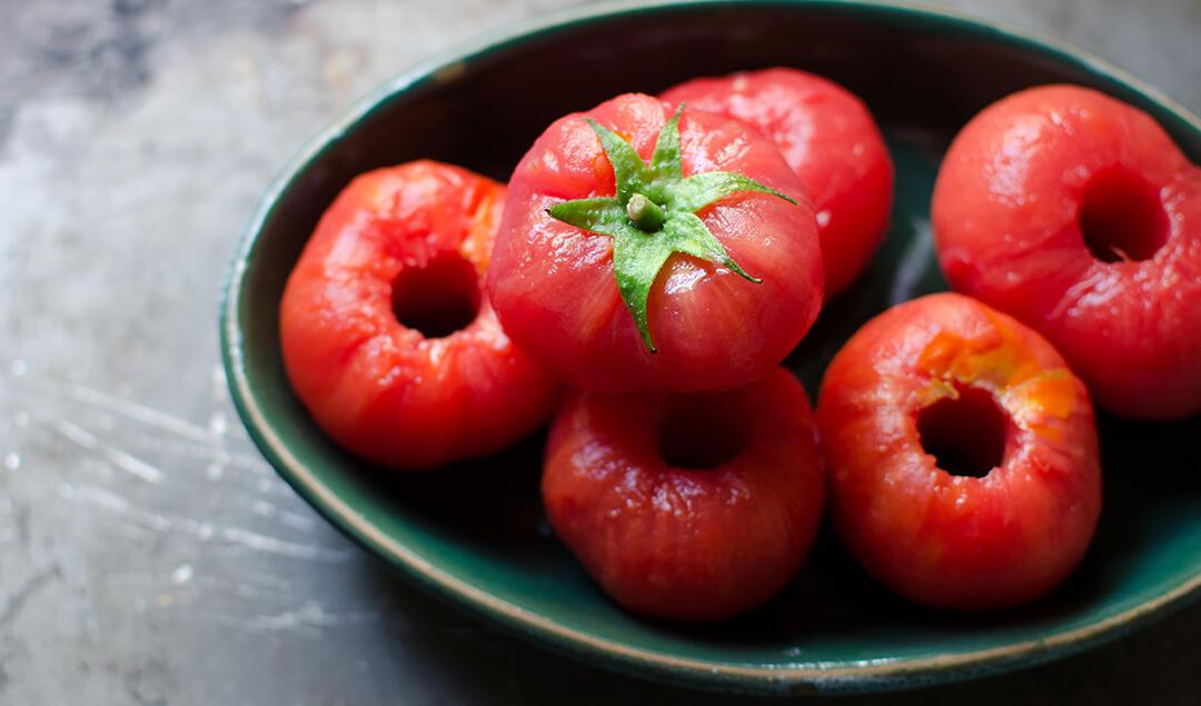 Bowl of peeled Shady Lady tomatoes.
