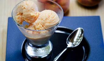 Scoop of Eggless Peach Ice Cream