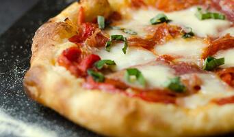 Nancy Silverton's pizza dough topped with peperonata, salumi, and pepperoni.